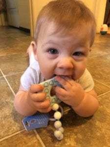 baby chewing on teether